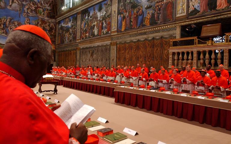 In this April 18, 2005, photo released by the Vatican paper L'Osservatore Romano, Cardinal Christian Wiyghan Tumi of Cameroun joins fellow cardinals in prayer inside the Sistine Chapel at the Vatican, at the beginning of the conclave. (Osservatore Romano/AP)