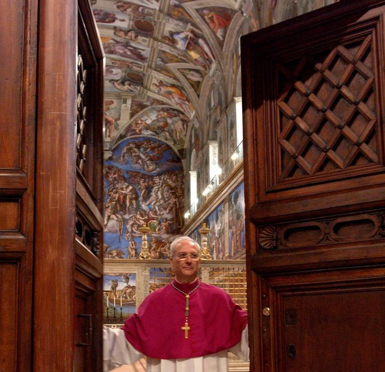 Master of Liturgical Celebrations Archbishop Piero Marini closes the door of the Sistine Chapel at the beginning of the conclave in 2005. (Osservatore Romano/AP)