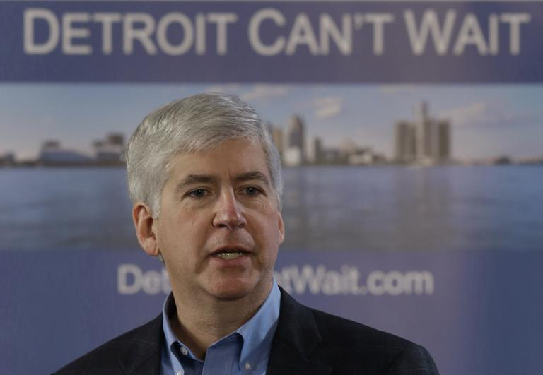 Gov. Rick Snyder declares a financial emergency during a broadcast in Detroit, Friday, March 1, 2013. (Paul Sancya/AP)