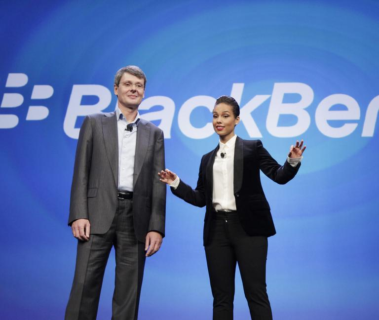 Thorsten Heins, CEO of Research in Motion, introduces Alicia Keys as the Global Creative director of BlackBerry, Wednesday, Jan. 30, 2013 in New York. (Mark Lennihan/AP)