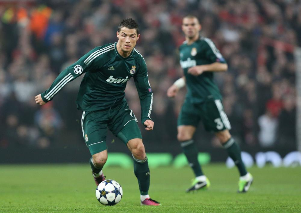 Taking on his former team on Tuesday, Cristiano Ronaldo delivered Real Madrid a 2-1 victory over Manchester United in Manchester with a second-half goal. (Jon Super/AP)