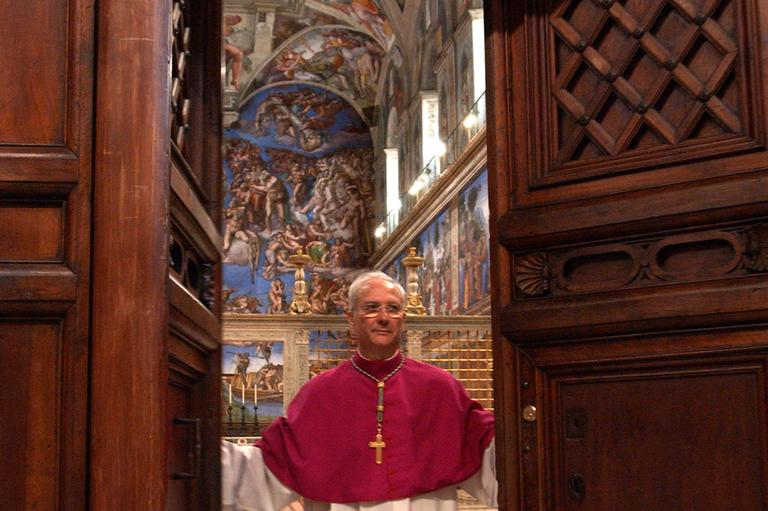 Master of Liturgical Celebrations Archbishop Piero Marini closes the doors of the Sistine Chapel at the Vatican on April 18, 2005, in preparation for the previous conclave. (Osservatore Romano/AP)
