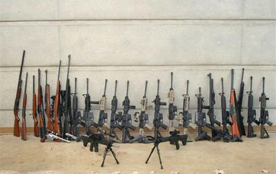 "Pictured are weapons seized using California's ""Armed Prohibited Persons System."" Federal agents seized 2,033 firearms, 117,000 rounds of ammunition, and 11,072 illegal high capacity magazines from January 1 to November 30, 2012, according to the California Attorney General's office. (California Attorney General's office)"