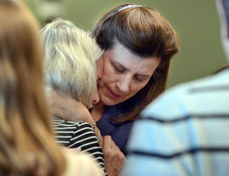 Prosecutor Lisa McGovern, right, hugs Mary Dunne, mother of Lauren Astley, after a jury found Nathaniel Fujita guilty of first-degree murder in the July 2011 killing of Astley, his ex-girlfriend. (MetroWest Daily News/AP, Pool)