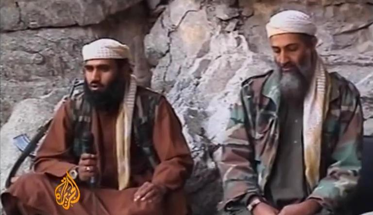 Sulaiman Abu Ghaith, left, is seen with Osama bin Laden in a video image released by Al Jazeera in 2001.