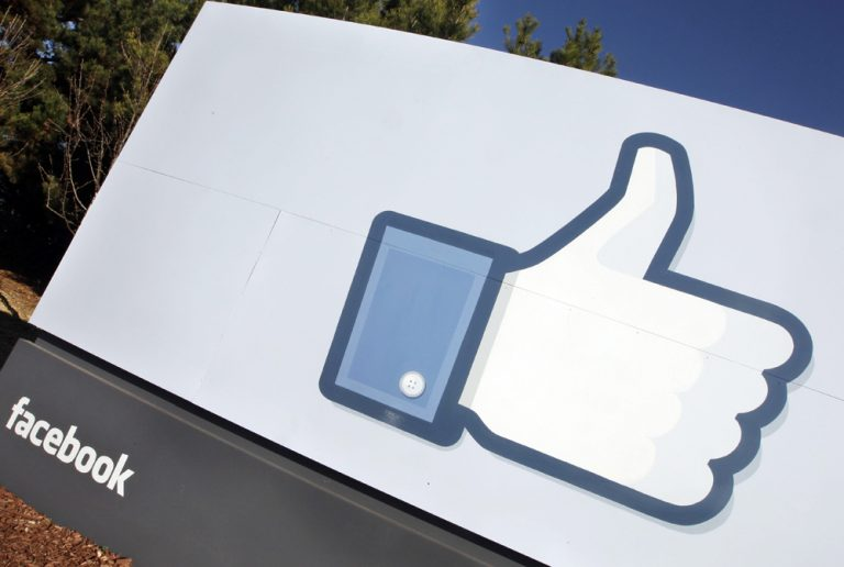 "The Facebook ""like"" icon is displayed outside of Facebook's headquarters in Menlo Park, Calif., Jan. 12, 2012. (Paul Sakuma/AP)"
