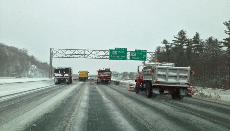 Snow plows barrel down Interstate-95 North in Georgetown Friday afternoon. (Jesse Costa/WBUR)