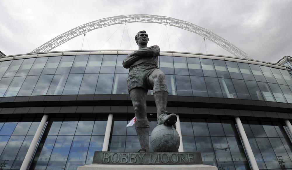This statue of Bobby Moore, captain of England's 1966 World Cup team, is among, if not the, most famous in Great Britain. (Tom Hevezi/AP)