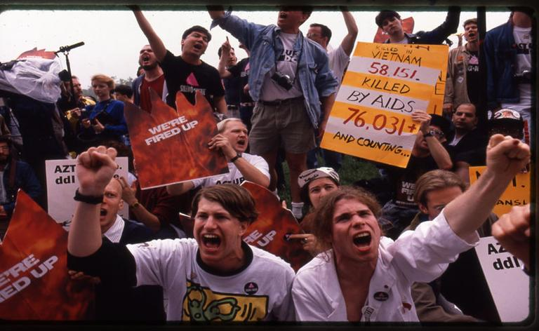 """An image from an ACT UP (Aids Coalition to Unleash Power) protest, featured in """"How to Survive a Plague."""" (Donna Binder)"""