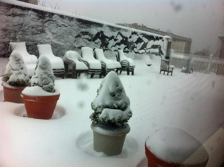 WBUR's roof patio is covered in snow Friday morning. (Thomas Melville/WBUR)