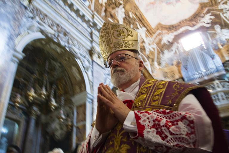 Boston Cardinal Sean O'Malley arrives to his titular church of Santa Maria alla Vittoria in Rome to celebrate Mass, Sunday. (Domenico Stinellis/AP)