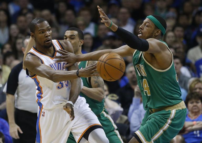 Oklahoma City Thunder forward Kevin Durant (35) passes in front of Boston Celtics forward Paul Pierce (34). (AP/Sue Ogrocki)