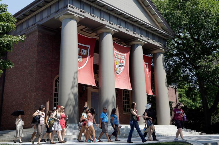 People are led on a tour of Harvard University in Cambridge on Aug. 30, 2012. (Elise Amendola/AP)