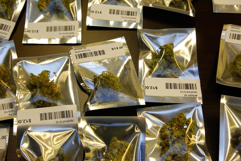 In this Nov. 7 file photo, medical marijuana is packaged for sale in a dispensary in Seattle. Massachusetts voters approved of medical marijuana on Election Day. (Ted S. Warren/AP)