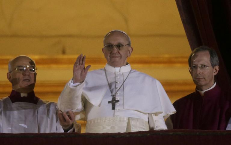 Pope Francis waves to the crowd from the central balcony of St. Peter's Basilica at the Vatican, Wednesday, March 13, 2013. (Gregorio Borgia/AP)
