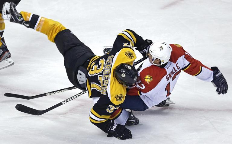 Bruins center Patrice Bergeron (37) collides with Florida Panthers right wing Jack Skille (12). (Charles Krupa/AP)