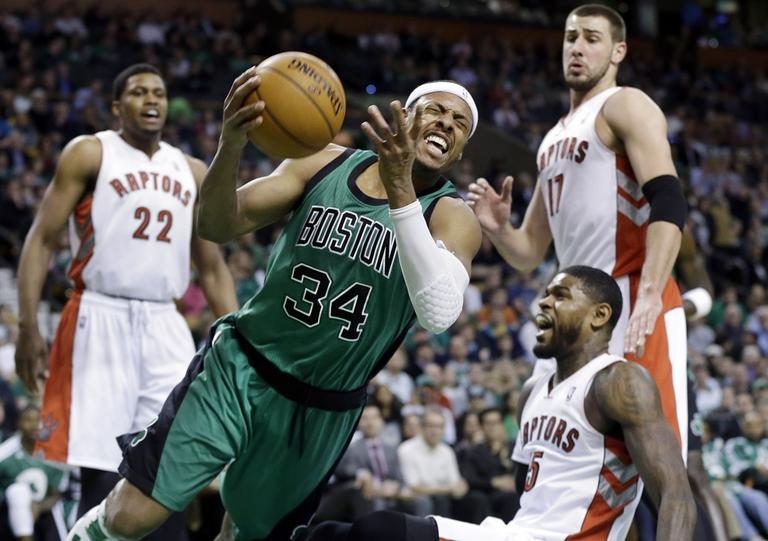 Boston Celtics forward Paul Pierce (34) drives Toronto Raptors forward Rudy Gay (22), center Jonas Valanciunas (17) and forward Amir Johnson (15). (Elise Amendola/AP)