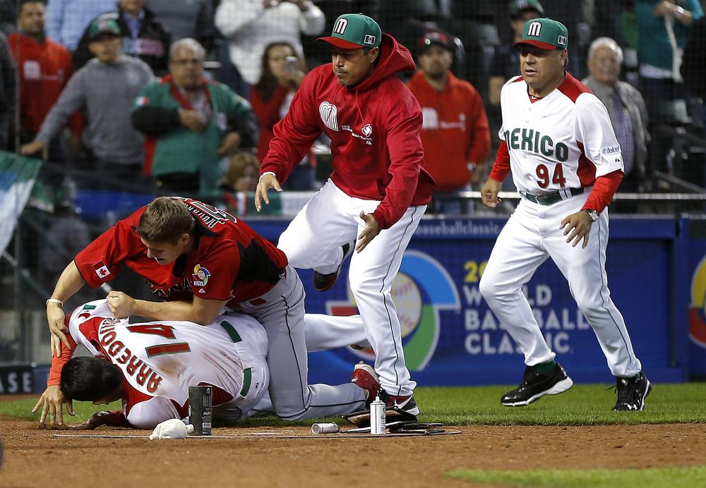 The scene turned ugly at the World Baseball Classic when Canada and Mexico squared off. (Matt York/AP)