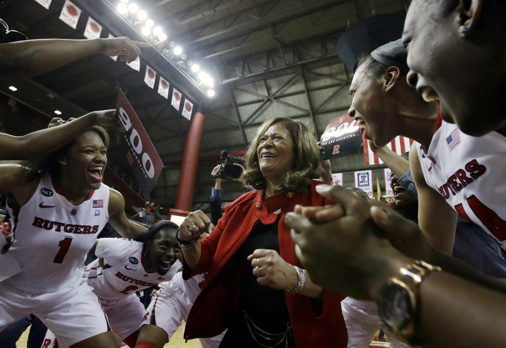 It took the Rutgers women's basketball team a couple of tries, but the Scarlet Knights eventually got Coach Vivian Stringer her 900th victory. (Mel Evans/AP)