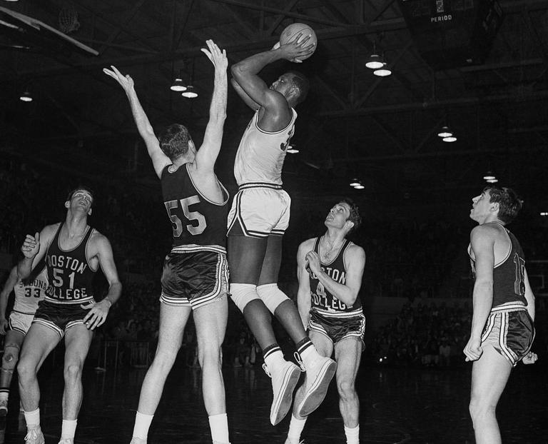 Bob Lanier (31), St. Bonaventure center goes up for basket and two points in NCAA regional basketball game against Boston College on March 9, 1968 in Kingston. (AP)