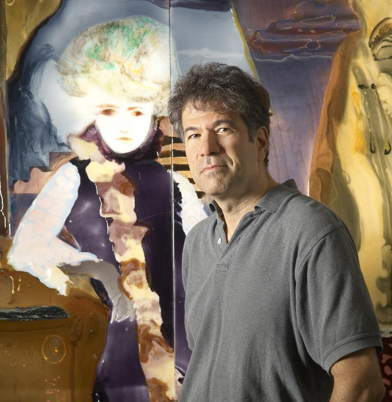 """Dr. Eric Finzi is author of """"The Face of Emotion."""" He's pictured in front of one of his paintings (he's also an artist)."""