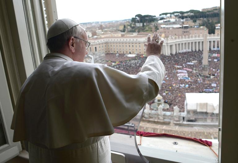 In this photo provided by the Vatican paper L'Osservatore Romano, Pope Francis delivers his Angelus prayer from the window of his studio overlooking St. Peter's Square, at the Vatican, Sunday, March 17, 2013. (L'Osservatore Romano/AP)