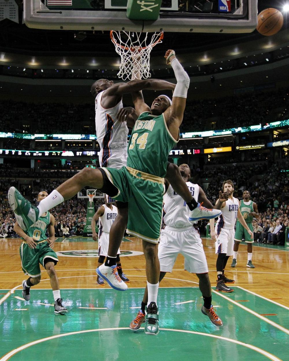 Charlotte Bobcats' Bismack Biyombo (0) blocks a shot byPaul Pierce (34) in Boston, Saturday, March 16, 2013. The Celtics won 105-88. (Michael Dwyer/AP)