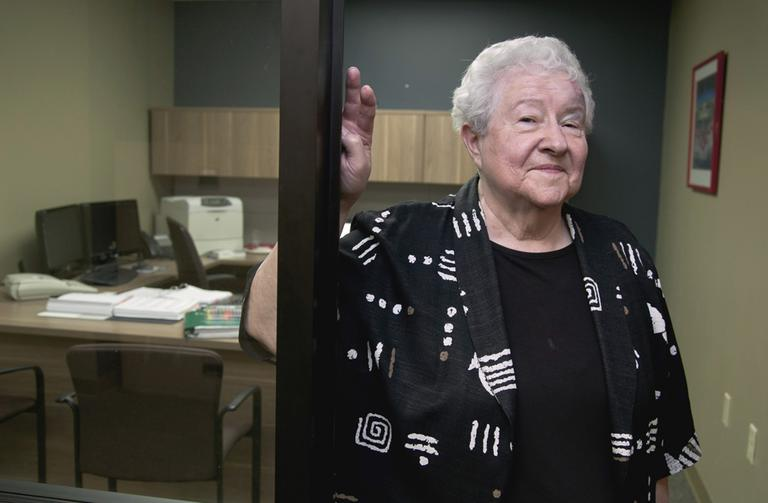 Janice Durflinger poses for a photo at her workplace in Lincoln, Neb., in August 2012. Durflinger is still working at age 76, running computer software programs for a bank. Still, she worries that a higher retirement age would be tough on people with more physically demanding jobs. (Nati Harnik/AP)