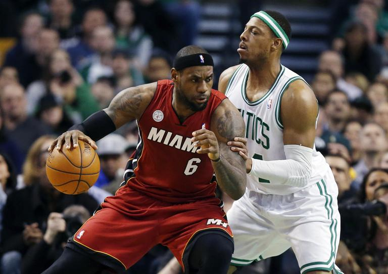 LeBron James looks to move past Paul Pierce in the first quarter. (AP)