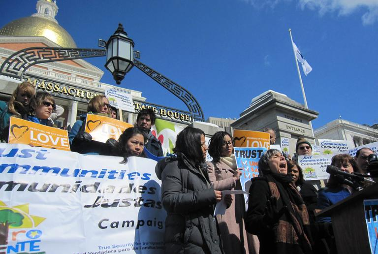 Immigration advocates rally on the State House steps Wednesday. (Asma Khalid/WBUR)