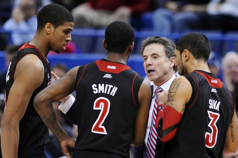 Louisville head coach Rick Pitino speaks with his players during the second half of their NCAA college basketball game against Connecticut in Hartford, Conn., Monday, Jan. 14, 2013. (Fred Beckham/AP)