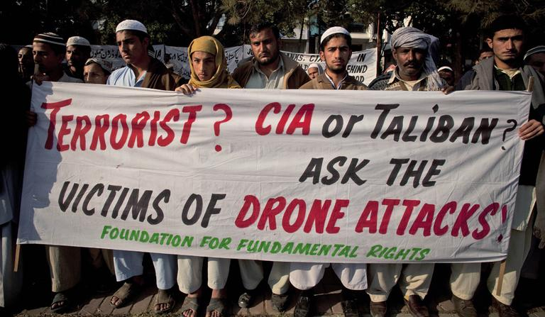 Pakistani tribal villagers hold a rally on Dec. 10, 2010, to condemn U. S. drone attacks on their villages in border areas along the Afghanistan border, in Islamabad, Pakistan. (B.K. Bangash/AP)