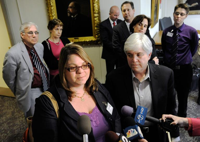 Jessica Port, front left, and her attorney Michele Zavos, front right, speak to reporters after the Court of Appeals of Maryland heard her case for divorce from her wife, Virginia Anne Cowan, back right, Friday, April 6, 2012, in Annapolis, Md. The couple married in California but were denied a divorce in Maryland. (Steve Ruark/AP)