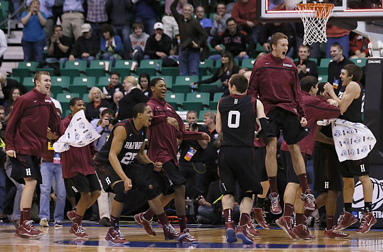 Harvard players run off the bench and celebrate after beating New Mexico during a second round game in the NCAA college basketball tournament in Salt Lake City Thursday. (George Frey/AP)