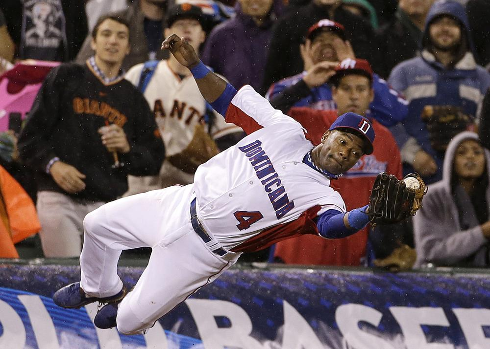 Fans who didn't watch this year's World Baseball Classic missed out on this catch by Miguel Tejada and other great plays. (Eric Risberg/AP)