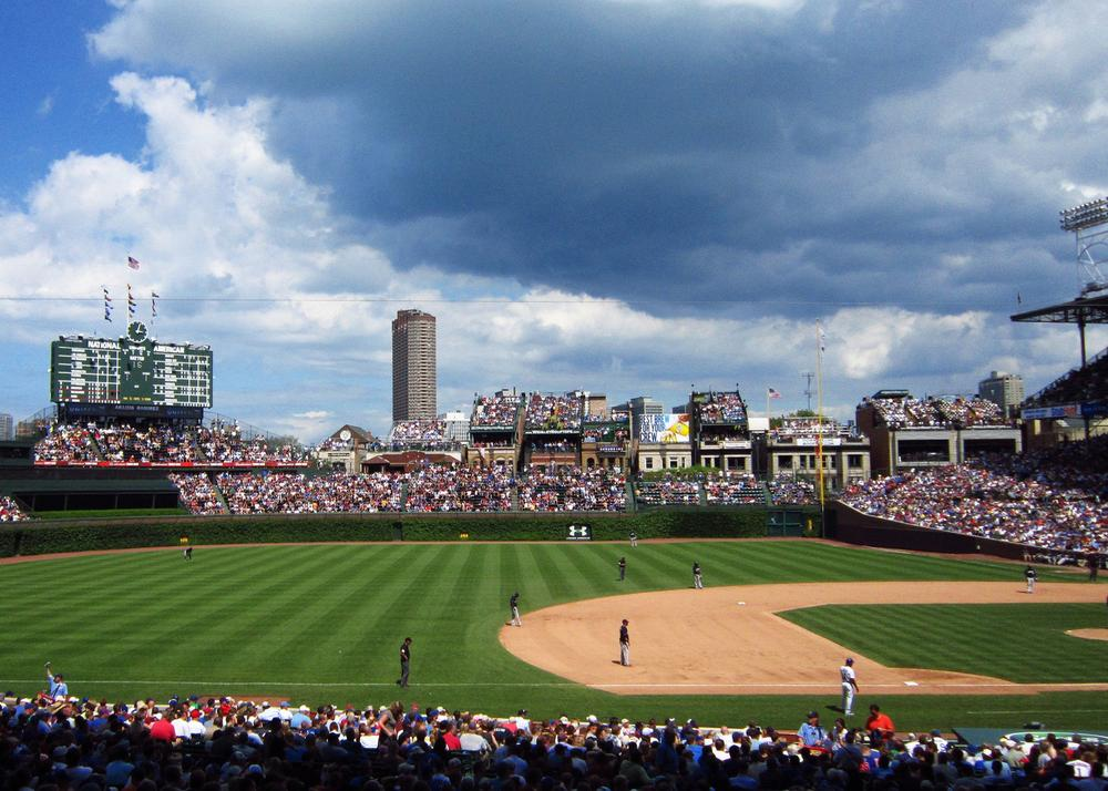 Cubs' owners would like to add a video screen to iconic Wrigley Field, but politicians, restaurant owners, and some fans don't like the idea. (Antonio Delgado via Flickr)