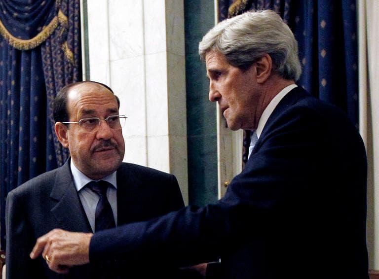U.S. Secretary of State John Kerry meets with Iraq's Prime Minister Nouri al-Maliki in Baghdad. (Jason Reed/AP Pool)