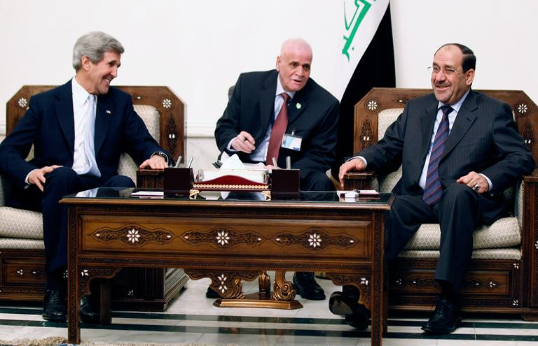 U.S. Secretary of State John Kerry, left, meets with Iraq's Prime Minister Nouri al-Maliki, right, in Baghdad Sunday. (Jason Reed/AP Pool)