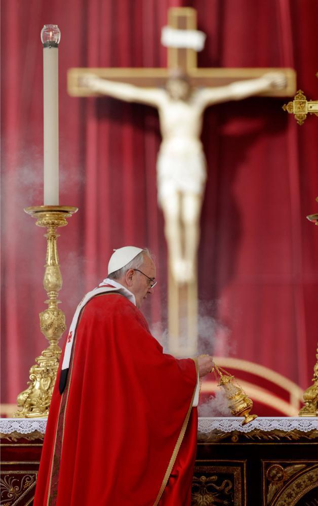 Pope Francis celebrates Palm Sunday Mass, in St. Peter's Square, at the Vatican, Sunday, March 24, 2013. (Andrew Medichini/AP)
