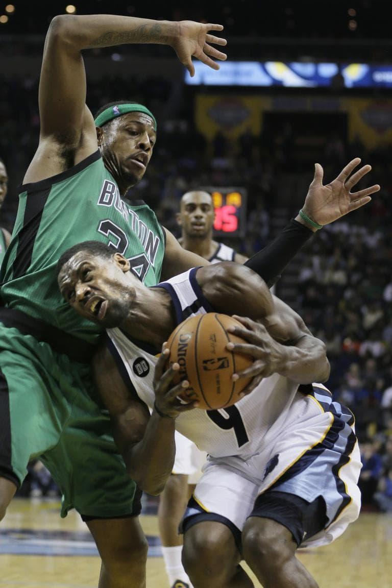 Celtics' Paul Pierce defends against Grizzlies' Tony Allenduring the second half of an NBA basketball game in Memphis Saturyda night. (Danny Johnston/AP)