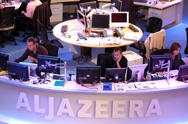 Al Jazeera English Channel staff prepare for the broadcast in Doha news room in Qatar on Tuesday, Nov. 14, 2006. (Hamid Jalaudin/AP)