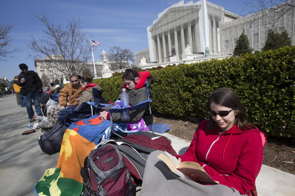 Dozens have been camping out for days in front of the U.S. Supreme Court for a seat to watch oral arguments in a same-sex marriage case that start Tuesday. (Jacquelyn Martin/AP)
