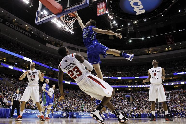 Florida Gulf Coast's Chase Fieler, top, dunks over San Diego State's Deshawn Stephens during the first half of a third-round game of the NCAA college basketball tournament, Sunday, March 24, 2013, in Philadelphia. (Matt Slocum/AP)