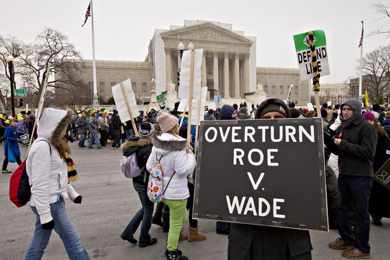 Anti-abortion activists march past the U.S. Supreme Court in Washington, Friday, Jan. 25, 2013, as they observe the 40th anniversary of the Roe v. Wade decision. (J. Scott Applewhite/AP)