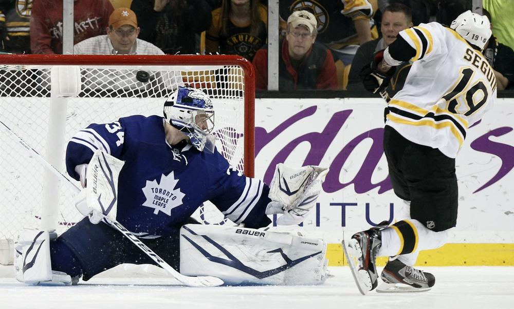 Tyler Seguin scores on Maple Leafs goalie James Reimer during the shootout in Boston's 3-2 win. (AP)
