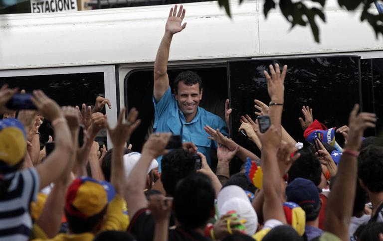 Venezuela's opposition presidential candidate Henrique Capriles waves to supporters during a rally in Carora, Lara State, Venezuela, Sunday, March 24, 2013. Capriles will run against a the late president Hugo Chavez' hand-picked successor Nicolas Maduro on April 14. (Ariana Cubillos/AP)