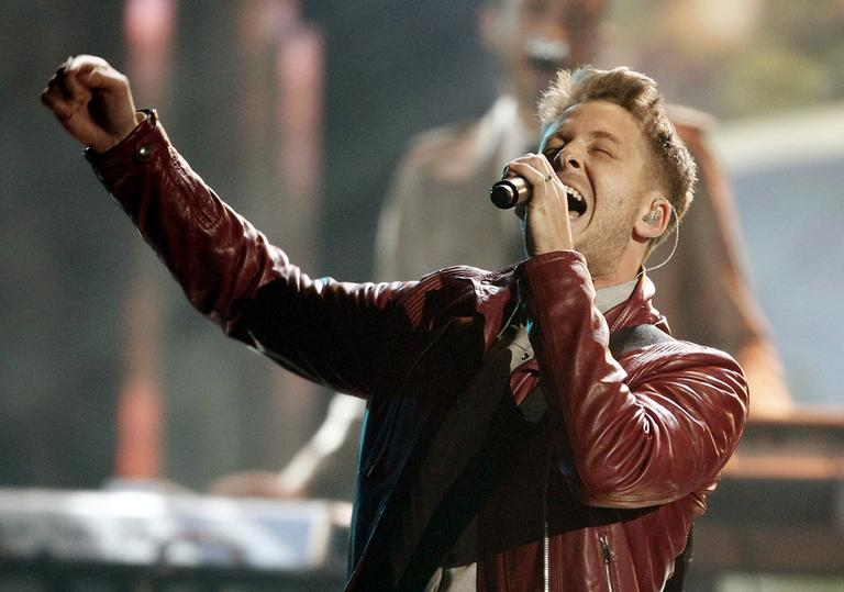Ryan Tedder and the band OneRepublic perform at the 39th Annual American Music Awards on Sunday, Nov. 20, 2011 in Los Angeles. (Matt Sayles/AP)