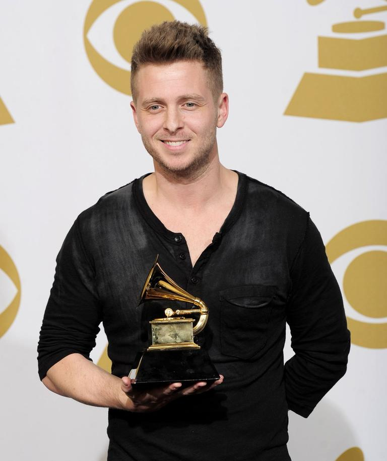 """Ryan Tedder poses backstage with the award for album of the year for Adele's """"21"""" at the 54th annual Grammy Awards on Feb. 12, 2012 in Los Angeles. (Mark J. Terrill/AP)"""