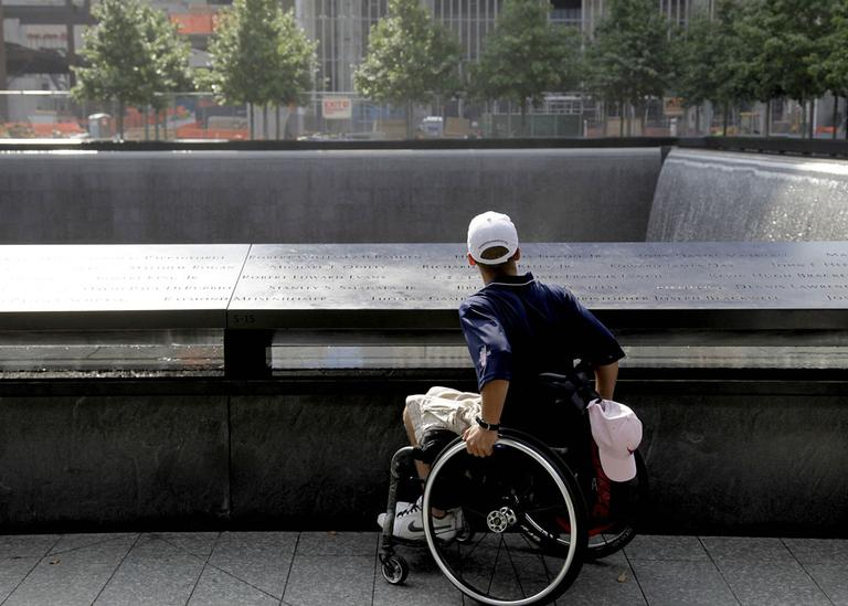 Marine Cpl. Tyler Huffman looks over a waterfall at the 9/11 Memorial in New York. (AP)