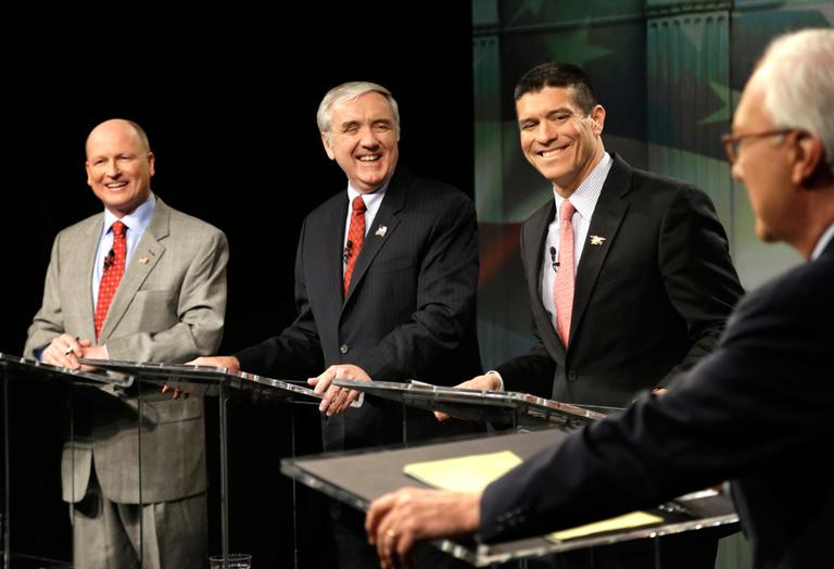 Republican U.S. Senate hopefuls, from left, Norfolk state Rep. Daniel Winslow, former U.S. Attorney Michael Sullivan and Cohasset businessman Gabriel Gomez react as they listen to debate moderator R.D. Sahl at the WCVB-TV studios in Needham on Wednesday. (Steven Senne/AP)